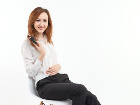 Makeup artist, beauty and people concept - Beautiful korean young woman holding make-up brushes on white background
