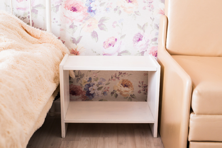 Interior and furniture concept - New cozy couch in the roomstylish fabric nightstand