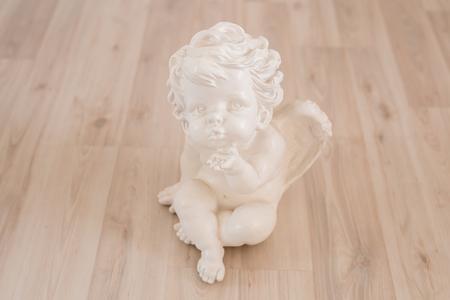 figurine and interior concept - white ceramic angel Imagens