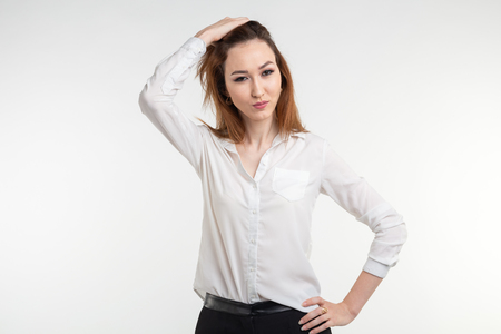 Portrait of a frustrated angry woman on white background