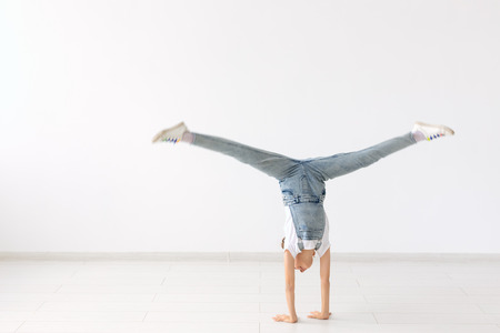 people, sport and children concept - pretty little girl doing gymnastics over white background 写真素材