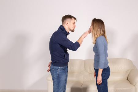 People, violence and abuse concept - Man and woman fighting