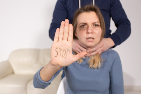 Alcoholism, abuse and problem concept - Sad woman shows stop sign, stop domestic violence