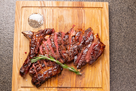 food, delicious, horse meat and craft concept - serving of grilled steak