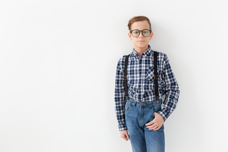 Style, children and family concept - cute teen boy posing on white background