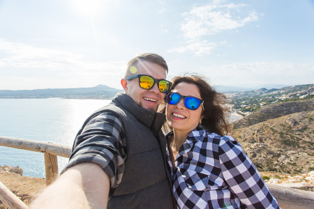 Travel, vacation and holiday concept - Beautiful couple having fun, taking selfie, crazy emotional faces and laughing. Stock Photo - 118924061