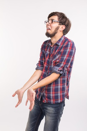 Emotions and people concept - bearded man confused and scared something, looks like he guilty Stock Photo