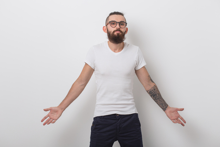 Beauty, fashion and people concept - portrait of hipster man with beard over white background 版權商用圖片
