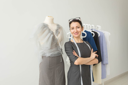 Dressmaker, fashion designer, tailor and people concept - Beautiful fashion woman designer standing in studio Stock fotó