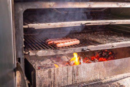 food, delicious and meat concept - roasting horse meat sausages grilled 免版税图像 - 119322590
