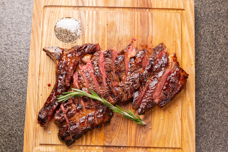 Food and horse meat concept - Roast meat on cutting board with cumin Stok Fotoğraf