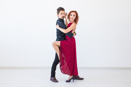 Romantic, social dance, people concept - couple dancing the salsa or kizomba or tango on white background with copy space