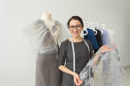 Dressmaker, fashion designer, tailor and people concept - Beautiful fashion woman designer standing in studio Imagens