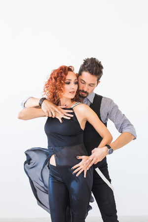 Social dance, salsa, zouk, tango, kizomba concept - beautiful couple dancing bachata on white background on white background Stock Photo