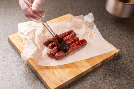 Food and delicious concept - Horse meat sausage covered with ketchup Imagens