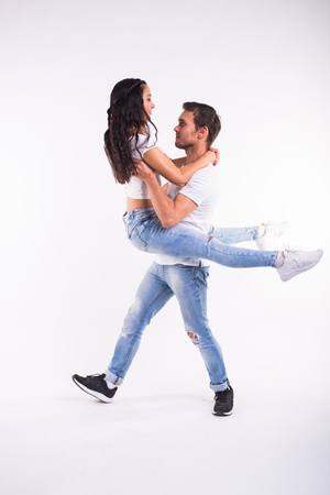 Young couple dancing social latin dance bachata, merengue, salsa. Two elegance pose on white background Stock Photo