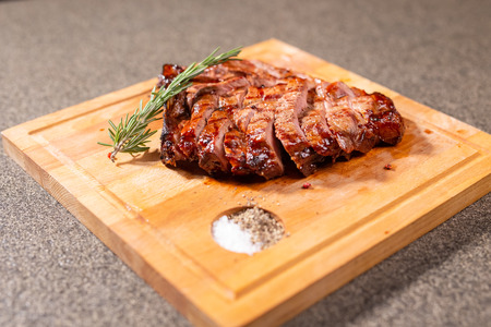 Food, delicious, horse meat and craft concept - serving of grilled steak.