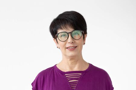 Portrait of a nice middle aged woman with glasses on white background Stock Photo
