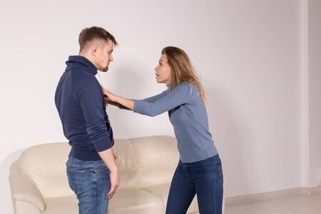 People and abuse concept - Aggressive man beats woman, domestic violence