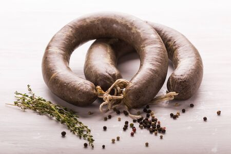 Food, meat and delicious concept - sliced horse meat sausage with cumin Reklamní fotografie