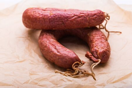 Food, meat and delicious concept - sausages made with horse meat on the table Reklamní fotografie