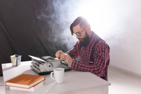People and technology concept - High angle view of bearded writer Reklamní fotografie