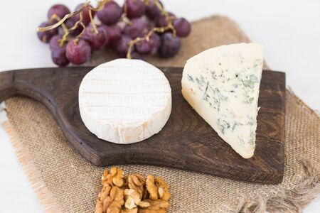 Blue cheese or brie with grapes and nuts