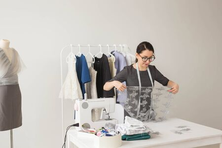 Dressmaker, tailor, fashion and showroom concept - Portrait of talented female dressmaker working with textile for sewing clothes Reklamní fotografie
