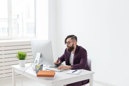 People, designer and technology concept - Man illustrator with thoughtful look, working environment