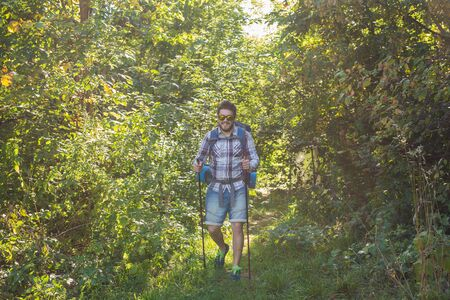 Adventures, summer tourism and nature concept - tourist arriving to a camping with his cat
