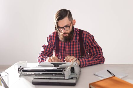 People and technology concept - Portrait of writer working on typewriter