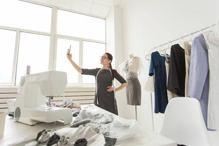 Dressmaker, technologies, fashion designer and tailor concept - Fashion designer taking selfies over mannequin background