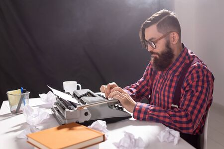 people, writer and hipster concept - young stylish writer working on typewriter