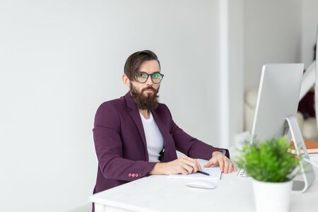People and technology concept - Man sits and works at the computer