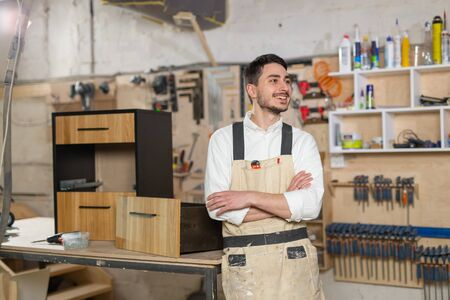 furniture factory, Small-Sized Companies and people concept - Portrait of a smiling male worker at manufacturing Stock Photo
