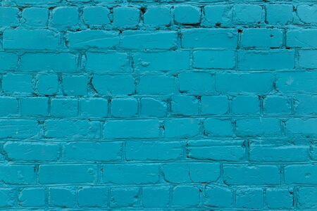 Brick wall. The brick wall painted in blue