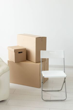Boxes with things during the move of residents to a new apartment. The concept of home buying and the hassle of moving