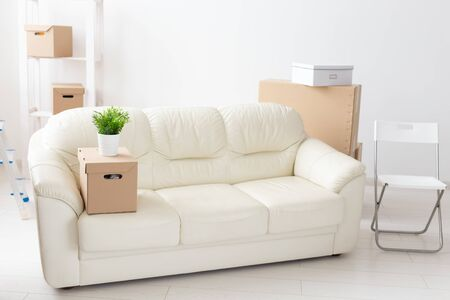 Cardboard boxes, sofa and carpet - moving to a new house