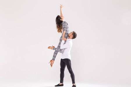 Skillful dancers performing in the white background with copy space. Sensual couple performing an artistic and emotional contemporary dance Stock fotó