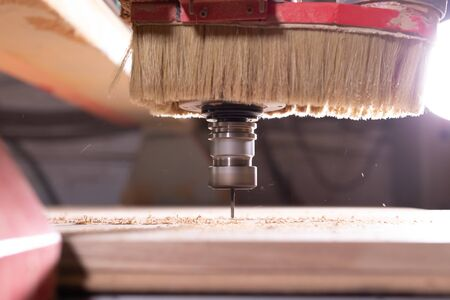 wood, metal, production concept - the cutting instrument, focus at the cutting process. Stockfoto