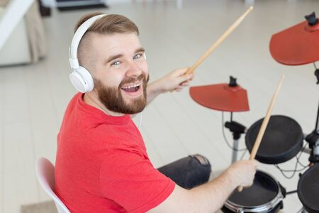 People, drums and hobby concept - Close up side view of musician with percussion instrument