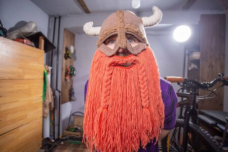 Halloween and carnival concept - a brutal viking in a mask