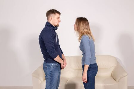 people, home violence and abuse concept - young couple screaming to each other