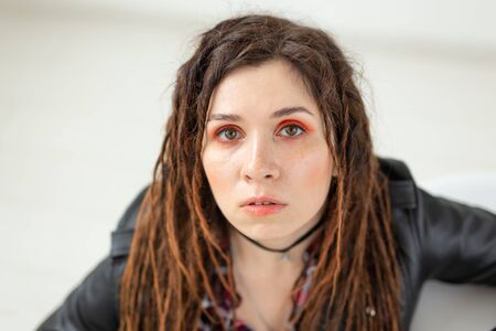 Dreadlocks, hairdresser and style concept - A funny girl with dreadlocks and in leather jacket and fashionable makeup