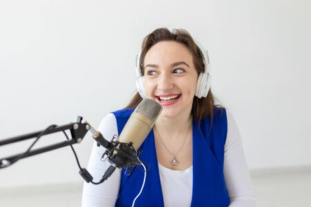 Radio, blogging, broadcast concept - woman dj is working on the radio