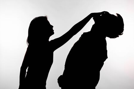 Domestic violence and abuse concept - Silhouette of a woman slapping a man