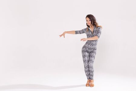 Latina dance, strip dance, contemporary and bachata lady concept - Woman dancing improvisation and moving her long hair on a white background