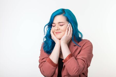 People, emotions and fashion concept - Beautiful girl with blue hair and joyful face on white background Фото со стока