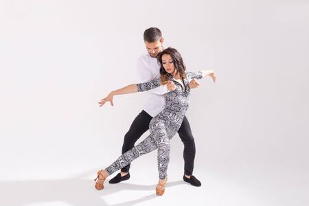 Passionate couple dancing social danse kizomba or bachata or semba or taraxia on white background with copy space Stock fotó - 130311036