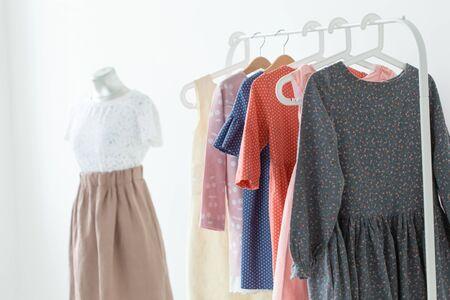 clothes, designer and Small-Sized Enterprises concept - a lot of clothes is on a hanger Stockfoto